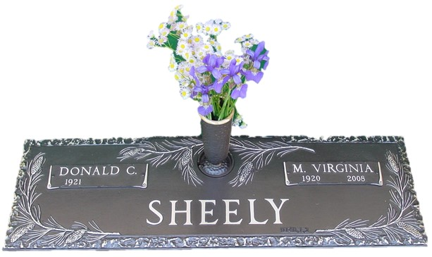 Bronze cemetery marker with pine bow and vase