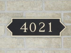 bronze house plaque with numbers