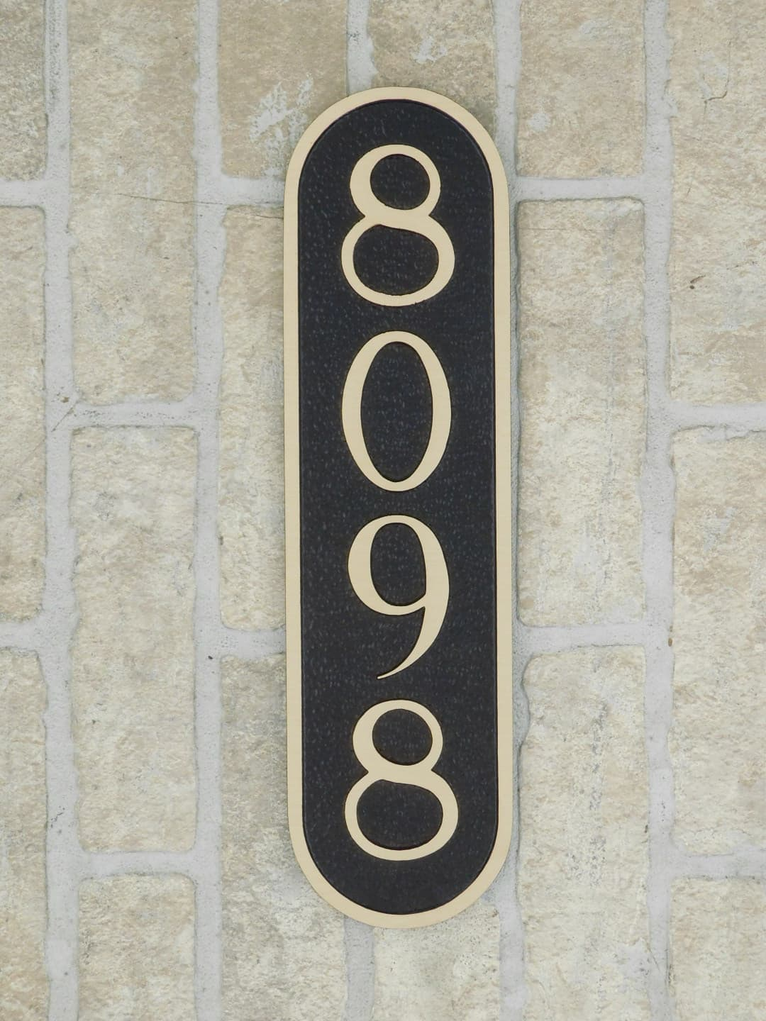 large bronze house number plaque